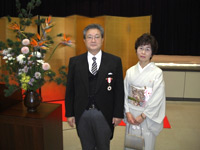 Dr Motokazu Hirao with his wife before departing for the Imperial Palace